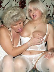 Elderly hotties Francesca and Eelene lapping each other and sharing a huge dildo