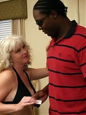 Naughty MILF Stacey exposes herself and lures a black guy into fucking her cunt