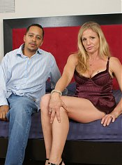 Sexy older gal Violet invites a black guy over to suck and ride his cock on webcam